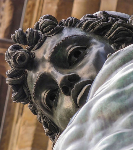Statue of Perseus Gazes Down at Camera with Serious Expression Bronze Florence Italy Gazing Hello Travel Close-up Curly Hair Day Discovery Eye History Human Representation Lips <3 No People Perseus Piazza Sculpture Staring Statue Strong