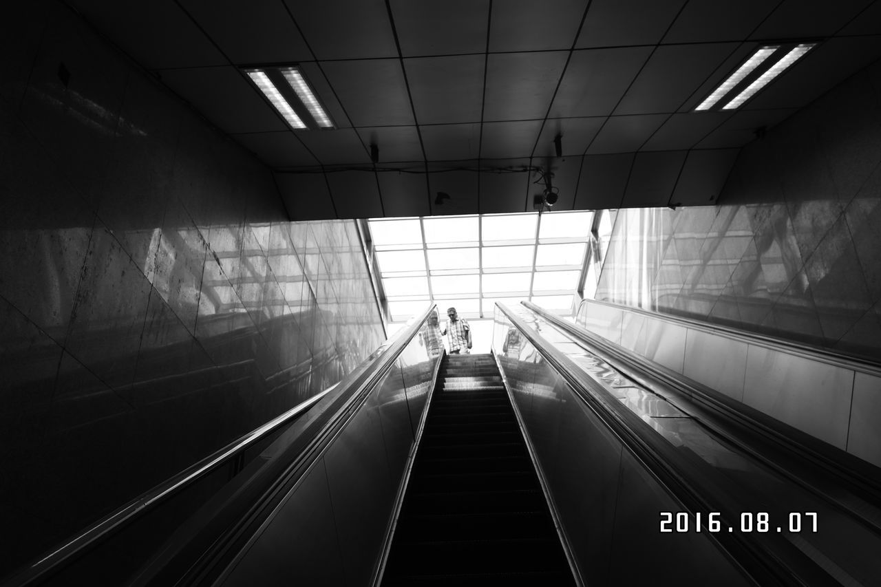 indoors, escalator, architecture, convenience, steps and staircases, staircase, transportation, built structure, real people, railing, illuminated, technology, men, steps, walking, airport, lifestyles, futuristic, women, modern, one person, day, people