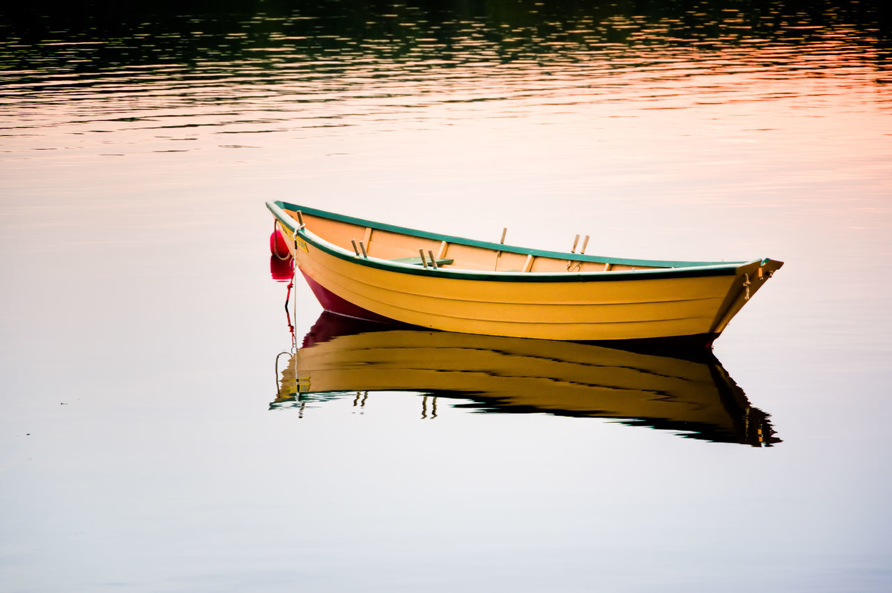Boat Moored At Lake During Sunset
