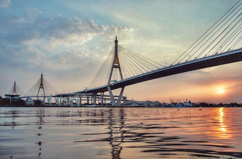 bridge sunset City Cityscape Urban Skyline Water Sea Nautical Vessel Horizon Sunset Steel Low Tide Steel Cable Cable-stayed Bridge Tall - High Man Made Structure Tide Bridge - Man Made Structure Spire  Skyscraper