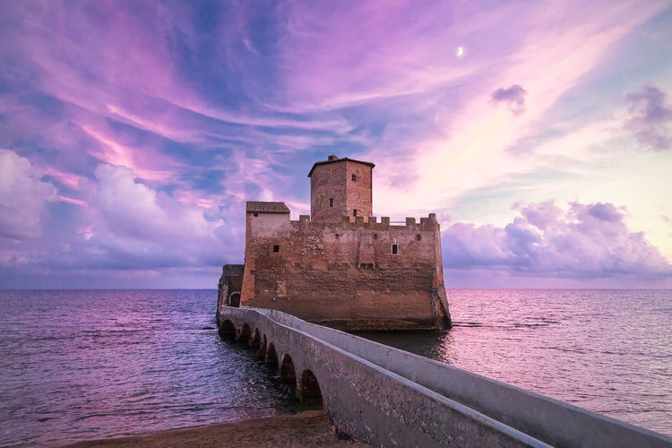 Astura Tower at sunset. Torre Astura, Italy. Ancient Bridge Castle Clowd Fortified Fortress Free Freedom No People Panorama Roman Romantic Ruins Sea Sky Sunset Torre Astura Tower Tranquil Scene Violet