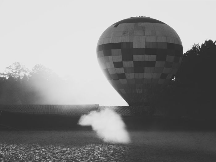 Foggy Rural Scene Dust Smoke Blackandwhite Black And White Light And Shadow Scenics Sky Nature Motion Architecture Day No People Clear Sky Built Structure Building Exterior Outdoors City Text Plant Tree The Traveler - 2018 EyeEm Awards The Great Outdoors - 2018 EyeEm Awards The Still Life Photographer - 2018 EyeEm Awards