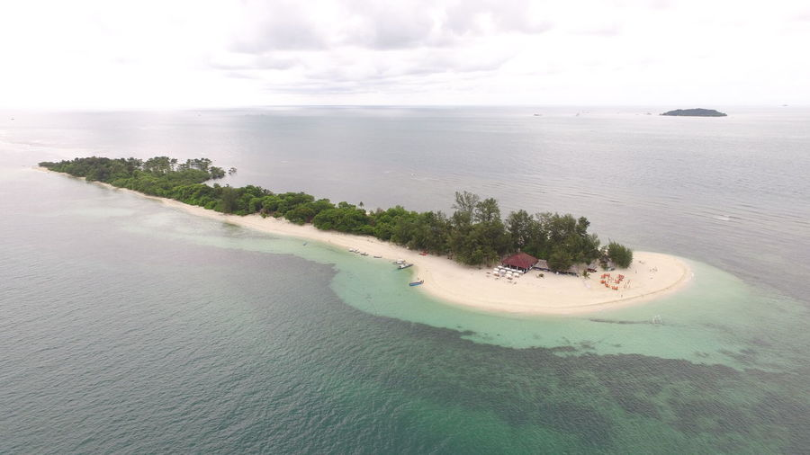 white sand island, bintan island indonesia Island View  Aerial View Beach Beauty In Nature Day High Angle View Island Land Nature Sea Sky Water