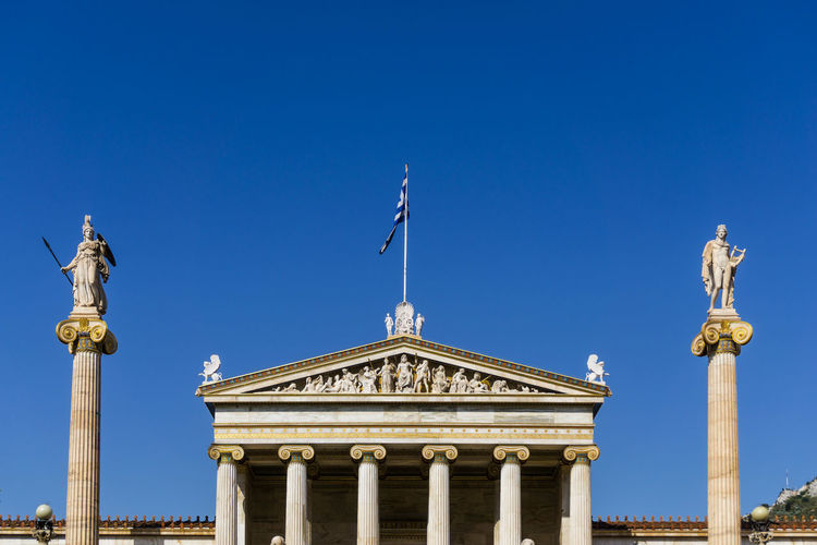 Architectural Column Architecture Blue Building Exterior Built Structure Clear Sky Day Flag History Human Representation No People Outdoors Sculpture Sky Statue Travel Destinations