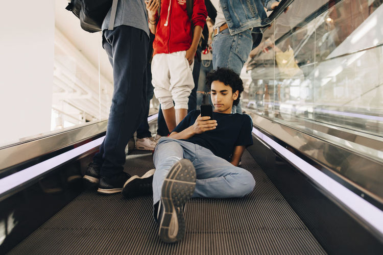 Low section of people on escalator in train