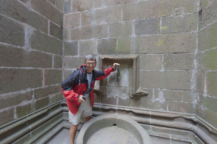 Man in medieval bathroom - Mont Saint-Michel, Normandy, France Ancient Architecture Basin Bath Bath Time France Man Mont Saint-Michel Tourist Tourist Attraction  Ancient Architecture Ancient Civilization Bathroom Bathtub Brick Wall Built Structure Mature Men Old Old Buildings One Man Only One Mature Man Only One Person Plumber Standing Washbasin