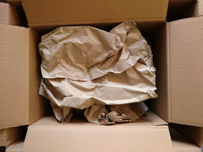 Directly above shot of crumpled paper in cardboard box