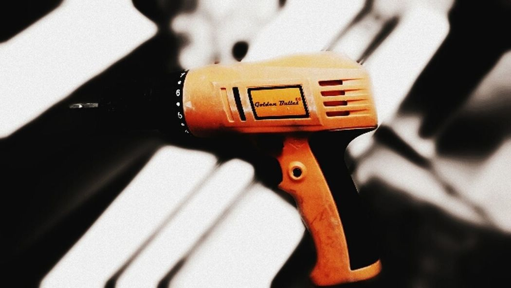 EyeEm Ready   Golden Bullet Orange Color Indianphotographer EyeEmNewHere Gun One And Only  Indoorsphotography No People Close-up Object One Click Click 📷📷📷 2017 ObjectPhotography Drilling Tools Mi4icamera EyeEm EyeEm Best Shots EyeEm Best Edits EyeEmBestPics EyeEm Gallery Eyeem Photography EyeEm The Best Shots Tool EyeEmNewHere