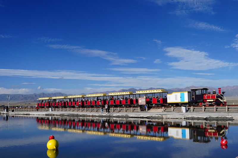 Train reflecting on river