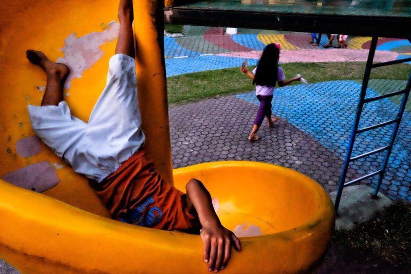 Boy Upside Down On Slide