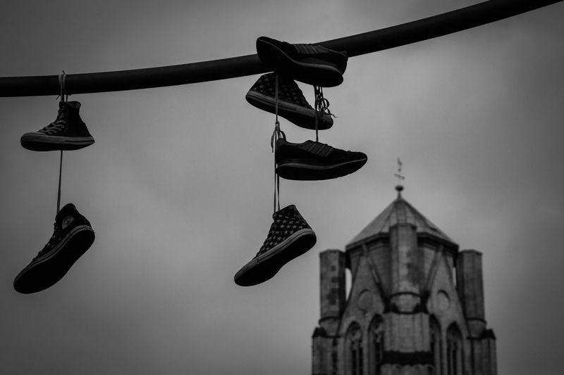 Shoes hanging from a cable