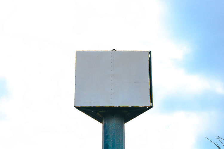 Low angle view of pole against sky