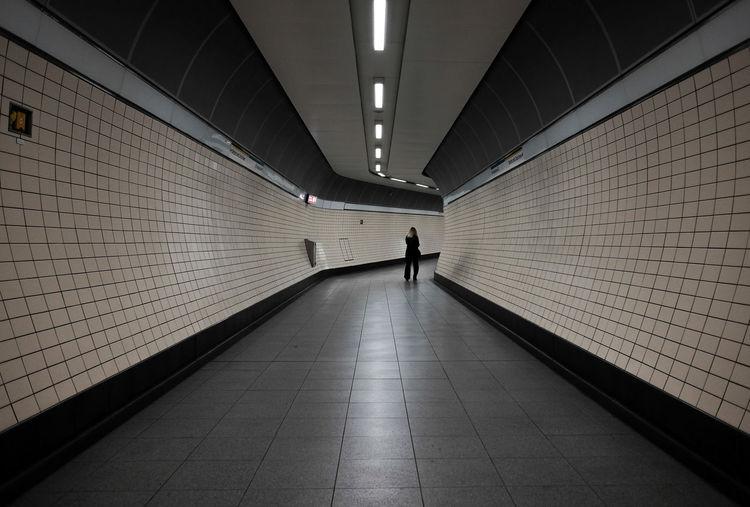Man in illuminated corridor