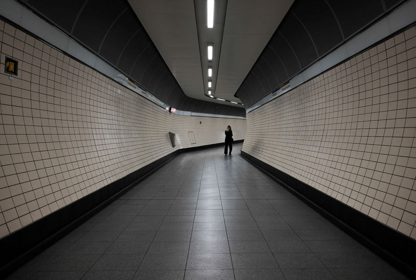Tube - London Tube Architecture Built Structure Diminishing Perspective Full Length Illuminated Indoors  One Person Real People The Way Forward Tile Postcode Postcards