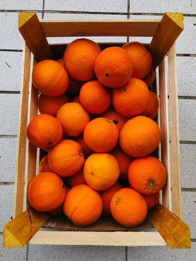High angle view of oranges in crate