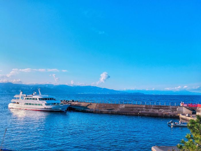 Isolated island trip Japanese Tourist Spots Nautical Vessel Mode Of Transport Transportation Blue Nature Sky Water Day Sea Outdoors Beauty In Nature Waterfront Tranquility Tranquil Scene Scenics No People Yacht Ships At Sea Ship Ships🚢 Isolated Island Island Trip Photo