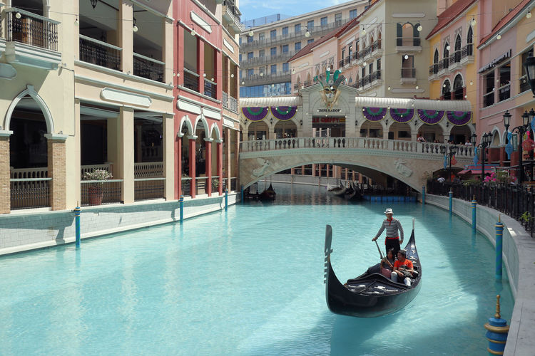 Gondola ride in Venice GrandCanal Mall at McKinley Hill, Manila Transportation Water Architecture Building Exterior Built Structure Gondola - Traditional Boat Canal City Travel Travel Destinations Real People Bridge - Man Made Structure Arch Manila Shopping Mall Venice Philippines GrandCanalMall Mall McKinley Hill Leisure Activity It's More Fun In The Philippines ASIA Gondola Ride Shopping