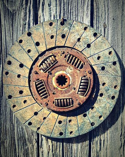 Brake disc hanging on weathered fence Metal Close-up Rusty No People Abstract View Texture Cellphone Photography Pattern Metal Work Weathered Automobile