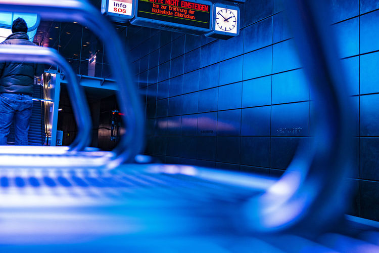 Blue Jeans Subway Station Bench U4 Realpeople Nikonphotography Transportation Architecture Communication Text Illuminated Mode Of Transportation Indoors  Sign Bicycle Blue Land Vehicle Western Script Selective Focus Focus On Background Motion City Travel Night Arrival