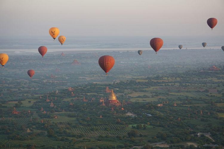Balloons Over Bagan Bagan Bagan, Myanmar Balloons Over Bagan Balloons Over Pagodas In Bagan Flying Hot Air Balloon Landscape Mid-air Outdoors Pagoda Travel Destinations