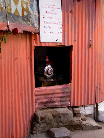 The smallest coffee shop of the world - new Delhi Architecture Built Structure Building Exterior Entrance Door No People Day Building Wall - Building Feature Red Outdoors Wood - Material House Safety Protection Security Abandoned Metal Old Open Coffee Shop India New Delhi