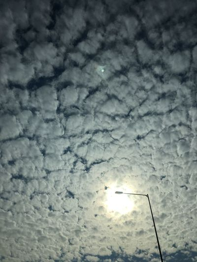 Low angle view of illuminated snow against sky during winter