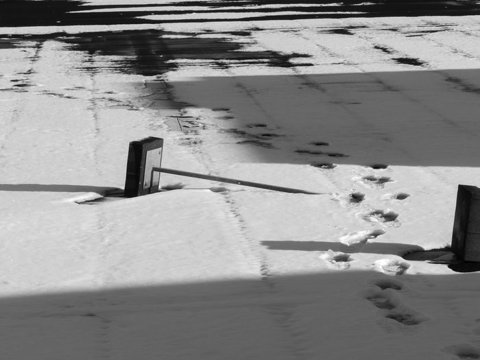 Outdoors The City Light Parkinggarage Snow Covered Footprints In The Snow Shadow Blackandwhite Nature Black And White Friday