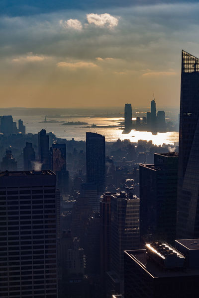 Building Sunset Skyscraper Tall - High Urban Skyline Financial District  Modern Tower Nature No People Office Building Exterior Architecture Cloud - Sky Cityscape Residential District Office Building Exterior Pollution Sky Outdoors City Built Structure Travel Destinations New York City