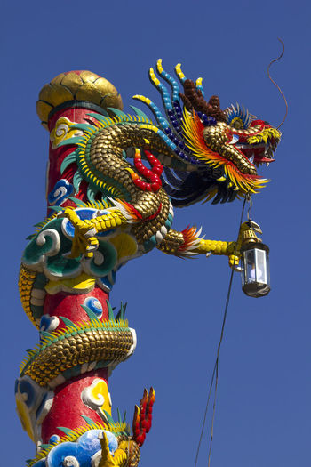 Golden dragon statue in Chinese temple Chinese Temple Ancient Architecture Golden Dragon Statue Architecture Art And Craft Chinese Dragon Chinese Temple Chinese Temple Decoration Craft Creativity Dragon Dragon Statue Dragon Statues Golden Dragon Golden Dragon Fly Golden Dragonfly Nature Outdoors Sculpture Sky Statue