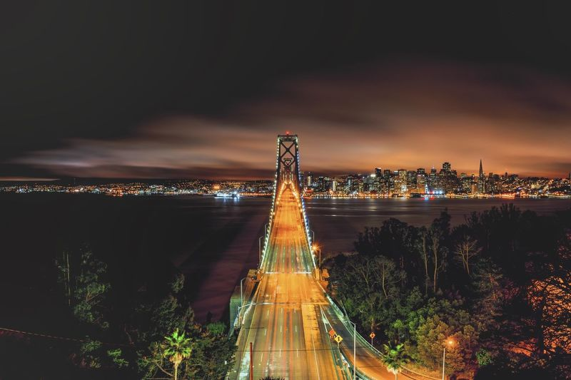 High angle view of bay bridge over ocean at night