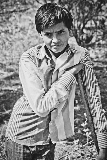 Street Boys standing own style and staring eyes. Relaxing The Portraitist - 2015 EyeEm Awards Black And White Monochrome Portrait Standing Boy