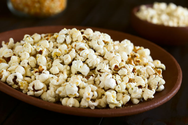 Homemade fresh savory popcorn with cheese, garlic and dried oregano on rustic plate, photographed with natural light (Selective Focus, Focus in the middle of the image) Crispy Garlic Herb Homemade Homemade Food Horizontal Rustic Cheese Cheesy Corn Crisp Food Food And Drink Fresh Freshness Oregano Pop Corn Popcorn Popped Puffed Ready-to-eat Savory Savory Food Snack Vegetable