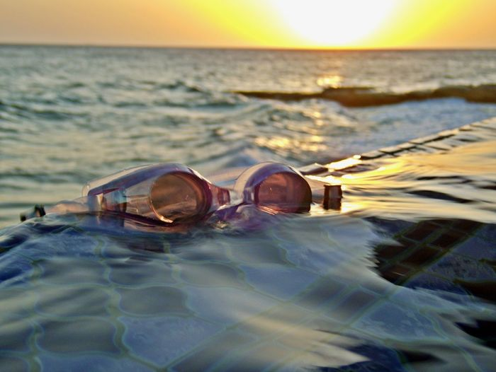 Sea Water Sky Horizon Over Water Nature Glasses Sunset Surface Level Scenics - Nature Outdoors Swimming Pool Scuba Mask Reflection Eyewear Horizon Sport Still Life Tranquility Vacation Time
