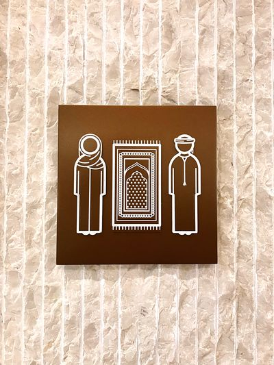 Signboard on a wall showing the location of the Mosque 🕌 Praying Sacred Muslim God Religion Mosque Public Restroom Bathroom No People Pattern Public Building Restroom Sign Communication Close-up Representation Wall - Building Feature Symbol Information