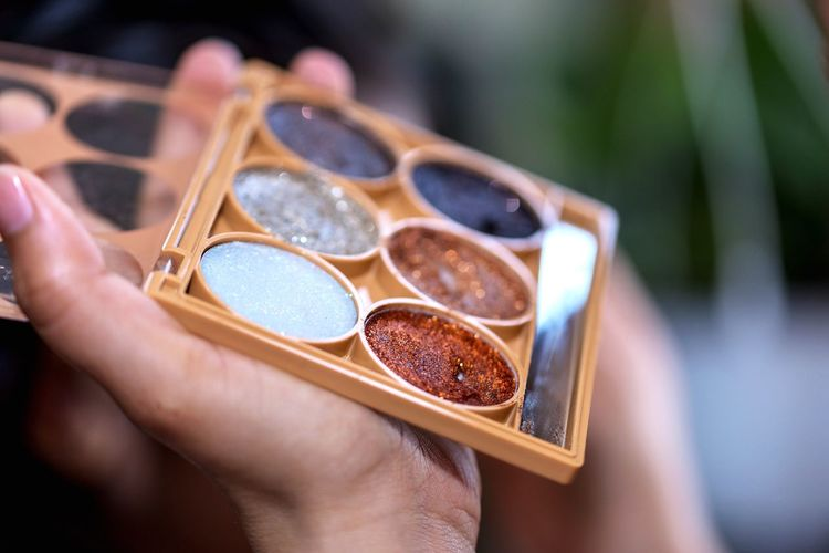 Close-up of hand holding make-up palette