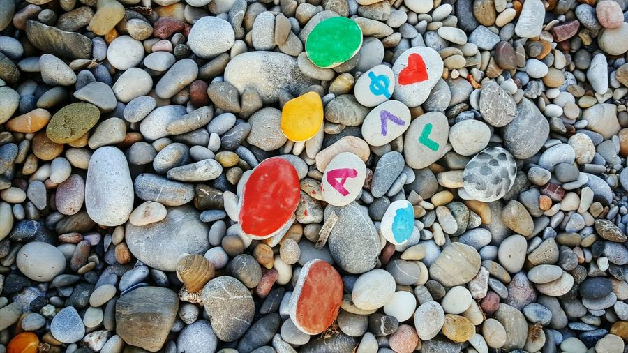 Colour Of Life Beach Stones HandPainted Colorful Family Time Initials Watercolours Abundance Beachphotography Watercolor Stones Summertime Having Fun Handpainting Watercolor Painting Family Power Life In Colors Family Matters Summer View From Above Malephotographerofthemonth