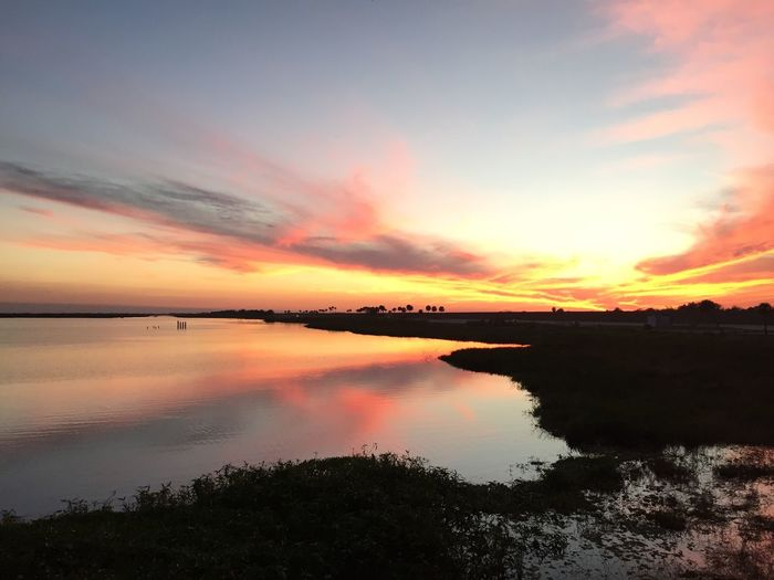 Lake Okeechobee Reflection Sunset Water Sky Tranquility Beauty In Nature Nature Cloud - Sky Scenics Tranquil Scene Outdoors No People Lake Day Florida Florida Sunset