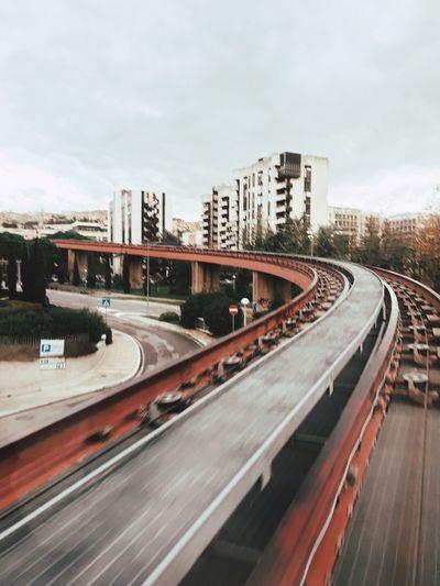 Bridge over highway in city against sky
