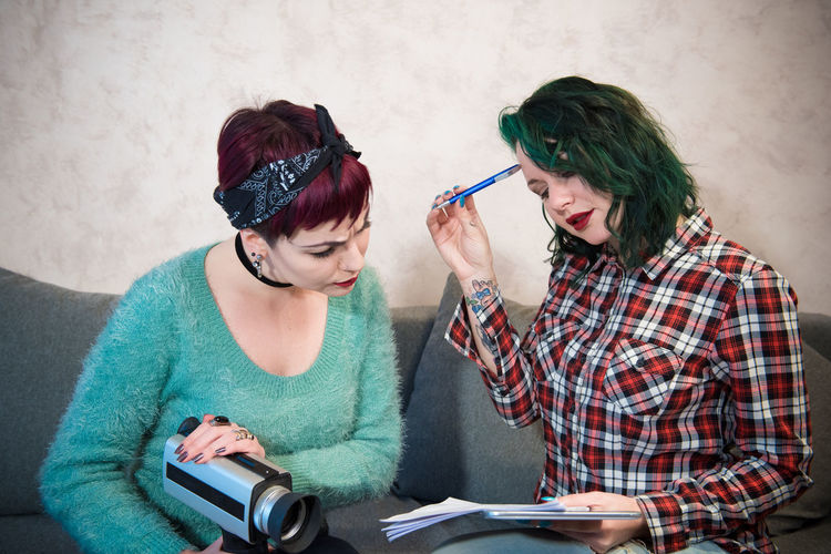 Two young women working together