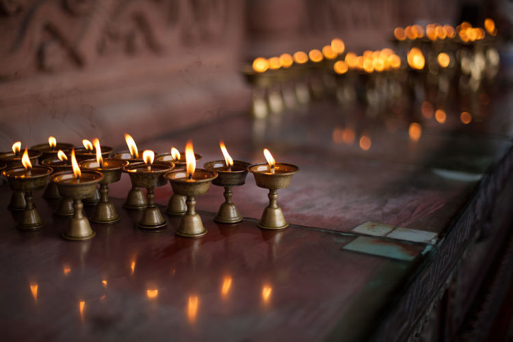 Oil lamps burning at temple