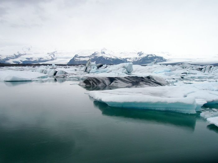 Beauty In Nature Blue Color Cold Temperature Floating On Water Ice Icebug Iceland Iceland Trip Icy Water Leicacamera Nature Sea Of Icebergs Seascape Tranquil Scene