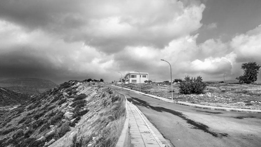 Cloud - Sky Sky Road Transportation Nature The Way Forward Direction Day No People Landscape Overcast Environment Sign Land Architecture Scenics - Nature Built Structure Mountain Outdoors Blackandwhite Black And White EyeEm EyeEm Best Shots EyeEm Nature Lover