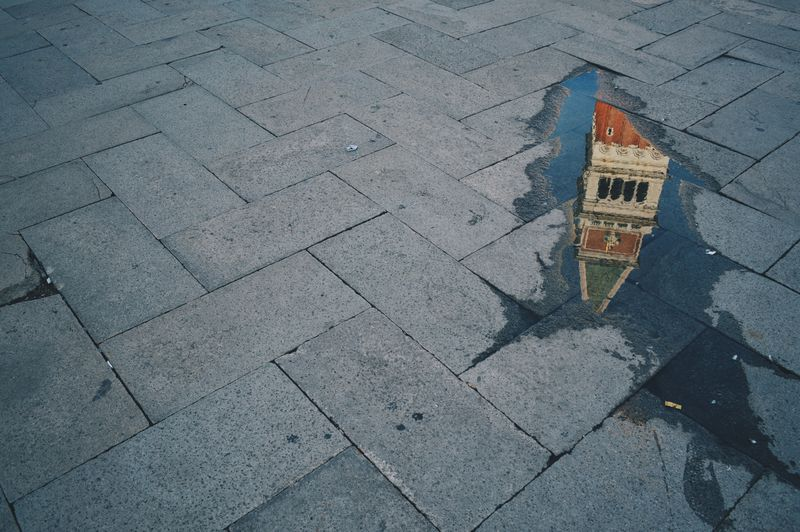 High angle view of st marks square reflecting on puddle