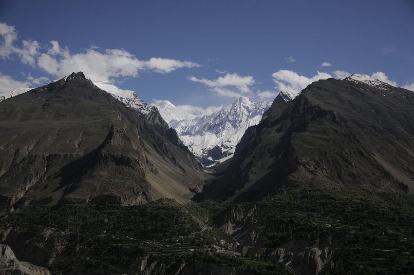 The beautiful view of Karimabad Hunza Valley at Pakistan Hunza Valley Pakistan Pakistan Beauty Blue Sky Day Getty Creative Gettyimages Karimabad Landscape Mountain Mountain Peak Mountain Range Mountains And Sky Nature No People Outdoors Sky Snow Montai Travel Destinations Valley Lost In The Landscape