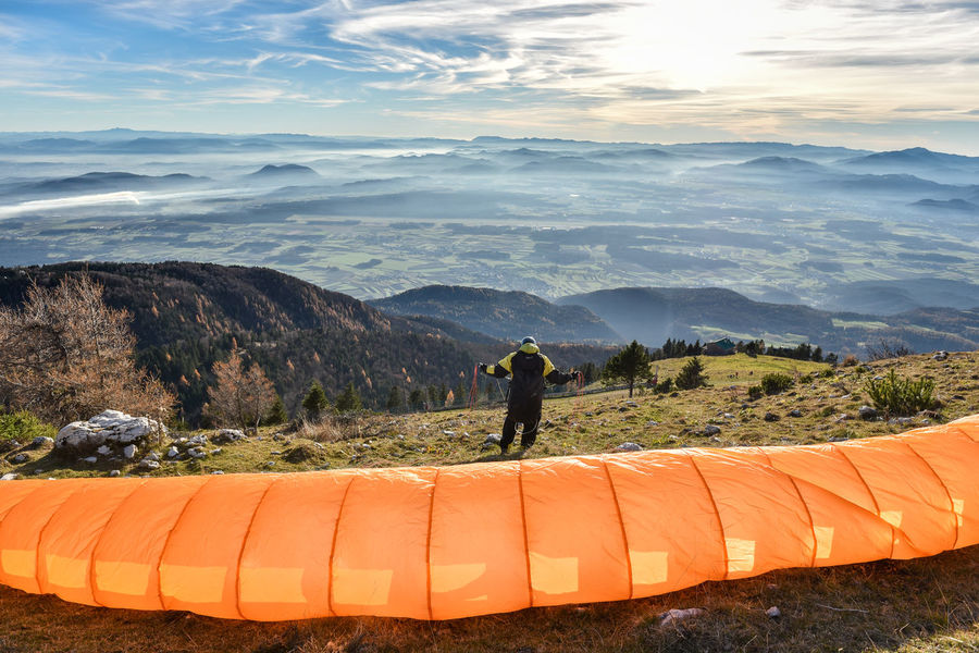 Active Active Lifestyle  Adventure Adventures Beauty In Nature Danger Day Extreme Flying Mountain Mountain Range Nature Orange Color Outdoors Parachute Paraglide Paraglider Real People Scenics Sky Slovenia Sport Starting Valley View