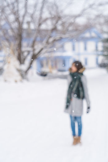 Winter Adult Blur Clothing Cold Temperature Day Defocused Extreme Weather Full Length Leisure Activity Lifestyles Nature One Person Outdoors Plant Real People Snow Snowing Standing Tree Walking Warm Clothing Water Winter Women
