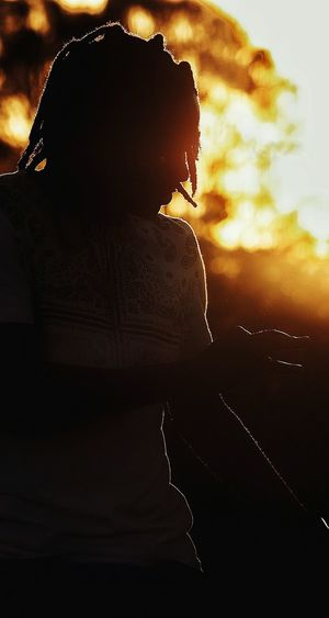 Portrait of silhouette woman against sky during sunset