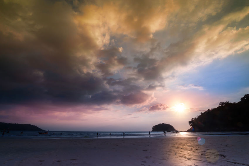 Sea at sunset with stunning rain cloud and twilight sky. Kata Beach,Phuket Thailand Stunning Scenery Tourists Beach Beauty In Nature Cloud - Sky Horizon Over Water Hurricane - Storm Idyllic Island Nature Outdoors Rain Clouds Sand Scenics - Nature Sea Silhoutte Photography Sky Storm Cloud Sunset Tranquil Scene Tranquility Travel Destinations Twilight Sky Water