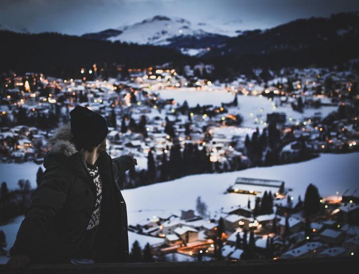 Man Against Illuminated Cityscape During Winter