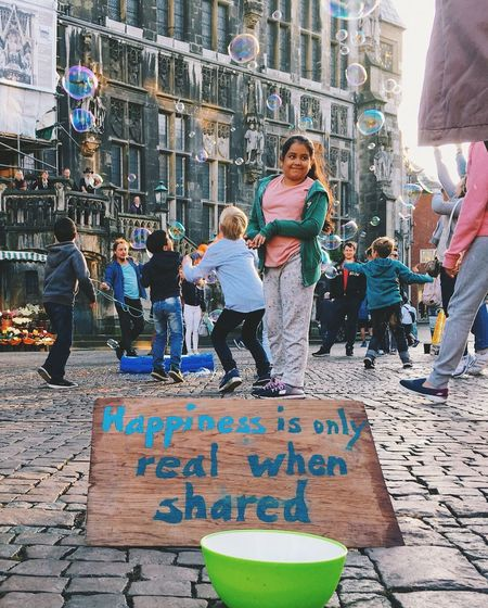 Happiness is only real when shared. Cityhall Share Happiness Bubbles Markt Rathausmarkt Child Outdoors Day Girls People Architecture Real People